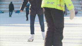 Portrait of Russian skater teen girl skillfully skating on public ice rink. Youth pastime and res stock video
