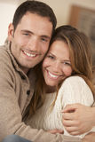 Portrait 30s couple hugging indoors Royalty Free Stock Photos