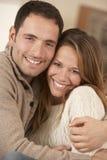 Portrait 30s couple hugging indoors Stock Image