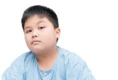 Portrait of s suspicious, cautious obese fat boy Stock Photos