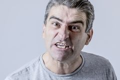 Portrait of 40s to 50s white angry and upset guy and crazy furious and aggressive face expression nagging and complaining. Isolated on grey background in stock photos