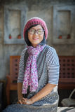Portrait of 40s years asian woman wearing wool hood and silk sca Stock Photos