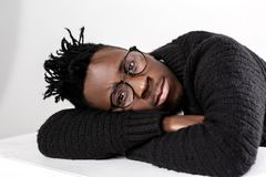 African-American man in glasses. Portrait of sad African-American man in glasses on a gray background Royalty Free Stock Photography