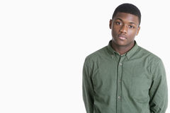Portrait of a sad African American man over gray background Stock Photos
