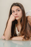Portrait of sad angel girl looking up and thinking with sorrow Royalty Free Stock Images