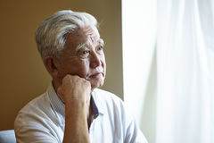 Portrait sad asian senior man Stock Photos