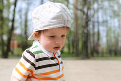 Portrait of sad baby boy outdoors Royalty Free Stock Images