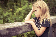 Portrait of sad blond little girl Stock Image