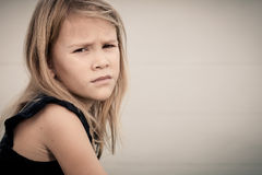Portrait of sad blond little girl Stock Photos