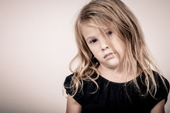 Portrait of sad blond little girl Stock Photography