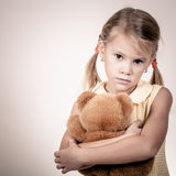 Portrait of sad blond little girl standing Royalty Free Stock Image