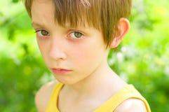 Portrait of a sad boy. Closeup portrait of a sad boy outdoors Stock Photos