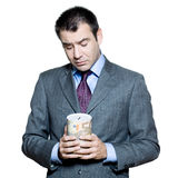 Portrait of sad businessman holding money box Royalty Free Stock Image