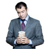 Portrait of sad businessman holding money box Royalty Free Stock Image
