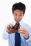 Portrait of a sad businessman showing his empty wallet Royalty Free Stock Photo