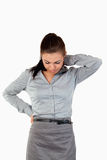 Portrait of a sad businesswoman having back pain Royalty Free Stock Image