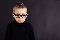 Portrait of sad child in pullover and glasses Stock Photography