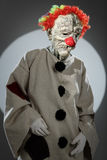 Portrait of sad clown with red nose. Royalty Free Stock Photography