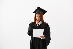 Portrait of sad confused insecure displeased african female university graduate preparing for her acceptance speech or. Sad displeased african female graduate in Royalty Free Stock Image
