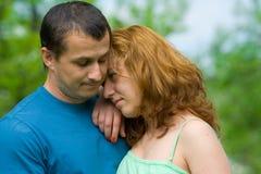 Portrait of a sad couple Stock Photos