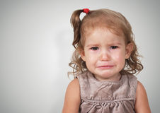 Portrait of sad crying baby girl Stock Photos