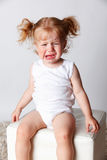 Portrait of a sad crying baby. Upset child throwing a tantrum Royalty Free Stock Images