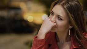 Portrait of sad crying brunette. Young beautiful woman upset with something. Background blurred. Melancholic woman wipe her tears under eyes and looks outside stock video footage