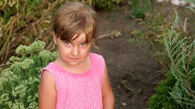 Portrait of a sad crying little girl in the Park. Portrait of sad little girl in Park, close-up of sad crying girl stock video footage
