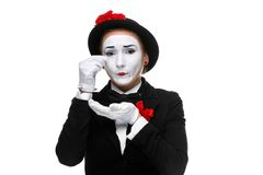 Portrait of the sad and crying mime. Portrait of the sad and crying woman as mime isolated on white background. Concept of resentment and bitterness Royalty Free Stock Images