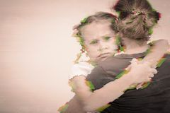 Portrait of a sad daughter hugging his mother. stock photo