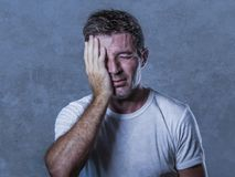 Portrait of sad and depressed man with hand on face looking desperate feeling frustrated and helpless in depression and sadness f. Acial expression concept stock photo