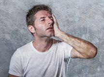 Portrait of sad and depressed man with hand on face looking desperate feeling frustrated and helpless in depression and sadness fa. Cial expression concept Royalty Free Stock Images