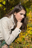 Portrait of a sad and depressed woman with problems in fall. Royalty Free Stock Photo
