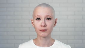 Portrait of a sad, depressed woman suffering from cancer looking into the camera. Stock footage of Portrait of a sad, depressed woman suffering from cancer stock video