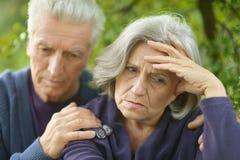 Portrait of a sad elder couple Royalty Free Stock Image