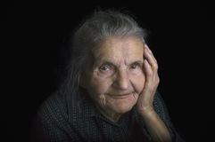 Portrait of a sad elderly woman. Dreaming the past. Stock Images
