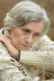 Portrait of sad eldery woman Stock Images