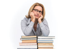 Portrait of sad female advocate leaning on books. Teacher at table with books on white background Stock Image