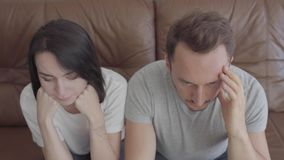 Portrait of sad frustrated men and women probably after a quarrel. Problems in the relationship between husband and wife stock video