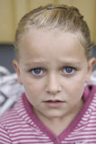Portrait of sad girl. Beautiful girl with big sad blue eyes looking into the camera. Soft focus Stock Image