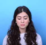 Portrait of sad girl against blue background Royalty Free Stock Photo