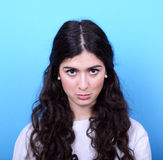 Portrait of sad girl against blue background Royalty Free Stock Photography