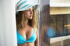 Portrait of sad girl in a beach hat Royalty Free Stock Photos