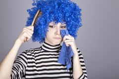 Portrait of sad girl with blue hair and comb. Royalty Free Stock Images