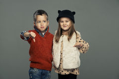 A portrait of sad girl and  boy. Thumbs down Royalty Free Stock Photos