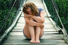 Portrait of a sad girl on the bridge Stock Images