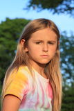 Portrait of sad girl. Cute little kid - thinking sad girl in colorful t-shirt Royalty Free Stock Photography