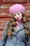 Portrait of a sad girl in a pink beret. The picture was taken in Russia, in the city of Orenburg, on Kobozev Street Royalty Free Stock Image
