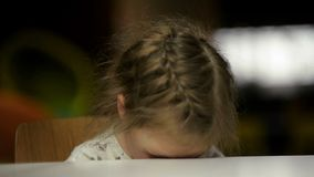 Portrait of Sad Girl Putting Her Head On Desk. Cutie Little Girl Is Going To Cry. stock video