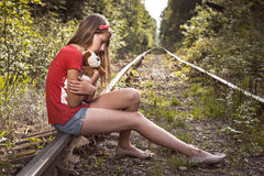 Portrait of a sad girl on the railway. Royalty Free Stock Photography